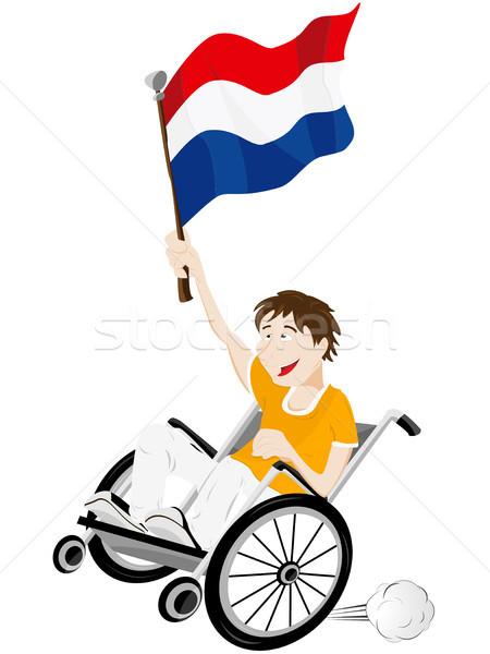 Sport fan aderente sedia a rotelle bandiera Foto d'archivio © gubh83