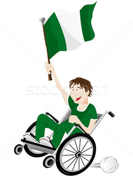 Nigeria sport fan aderente sedia a rotelle bandiera Foto d'archivio © gubh83