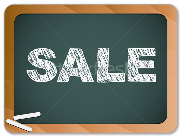 Sale written on blackboard with chalk. Stock photo © gubh83