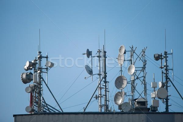 Muitos telhado alto edifício céu telefone Foto stock © Gudella
