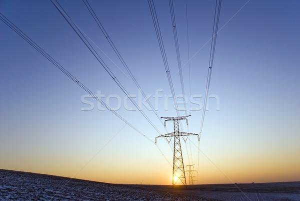 Alta tensione costruzione sole tramonto tecnologia inverno Foto d'archivio © guffoto