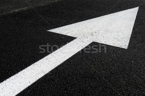 Fehér nyíl út út aszfalt Stock fotó © guffoto