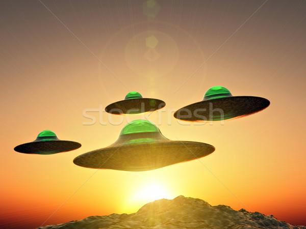 Ufo formación vuelo montanas puesta de sol cielo Foto stock © guffoto
