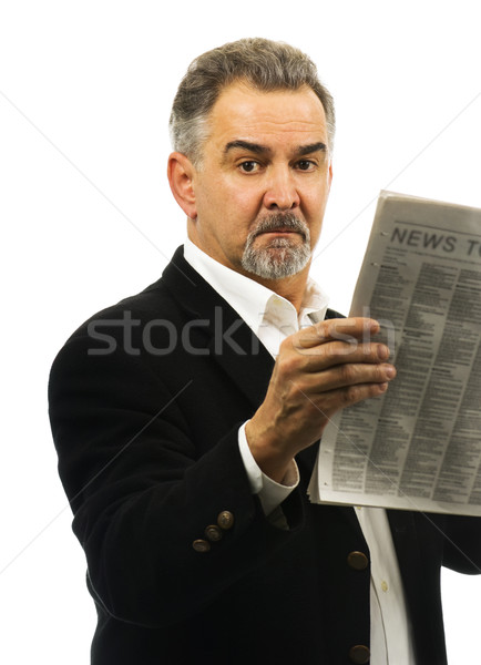 Mature man holds a newspaper, looking serious. Stock photo © Habman_18