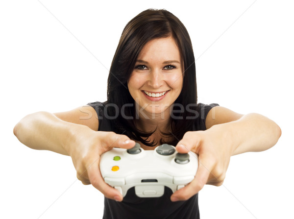Smiling girl with remote video game controller Stock photo © Habman_18