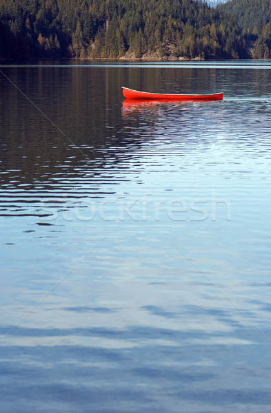 Stock photo: Empty canoe on lake