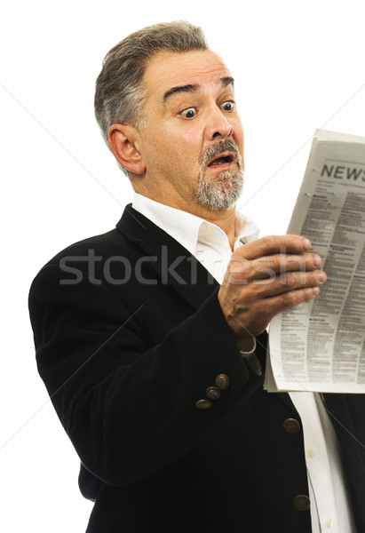 Man reads newspaper with look of shock Stock photo © Habman_18