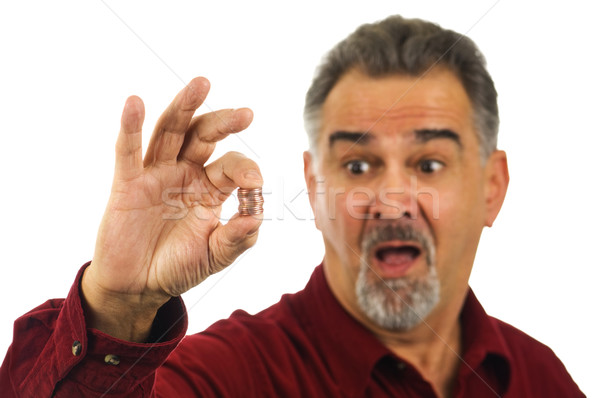 Man holding coins with look of shock on his face Stock photo © Habman_18