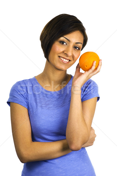 Stock photo: Young ethnic woman holds an orange.