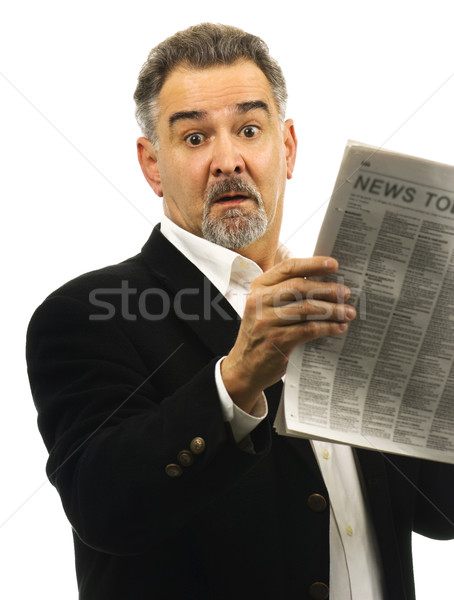 Man looks shocked while reading newspaper Stock photo © Habman_18
