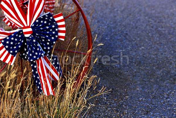 Red, white and blue bow on metal wheel Stock photo © Habman_18