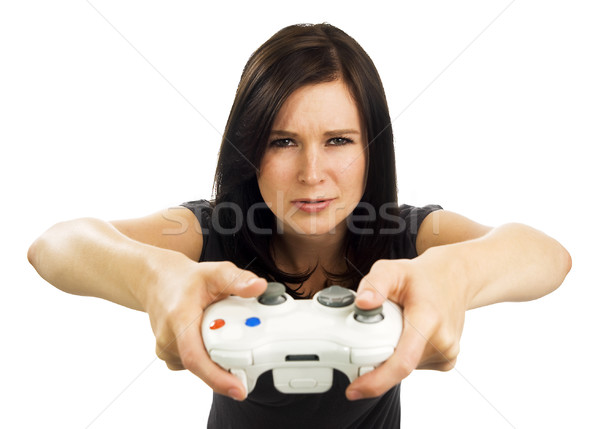 Serious looking girl plays video game Stock photo © Habman_18