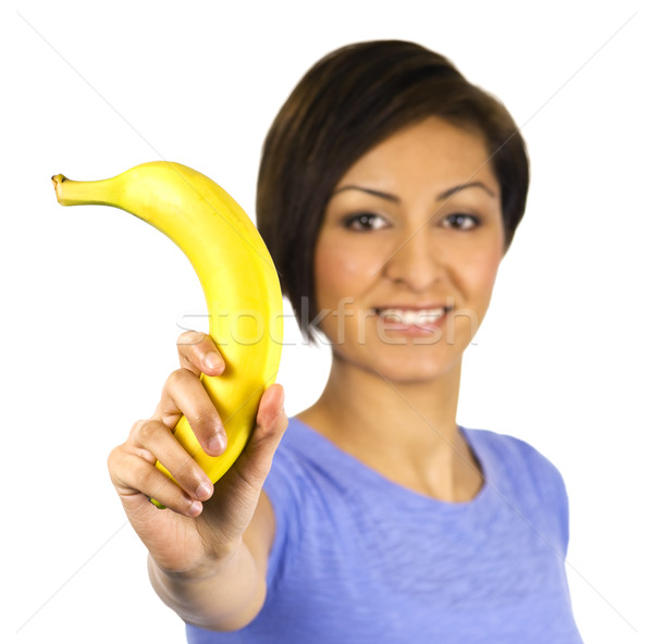Smiling young woman holds a banana Stock photo © Habman_18