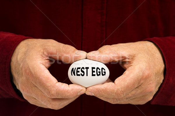 Man holds white egg with NEST EGG written on it Stock photo © Habman_18