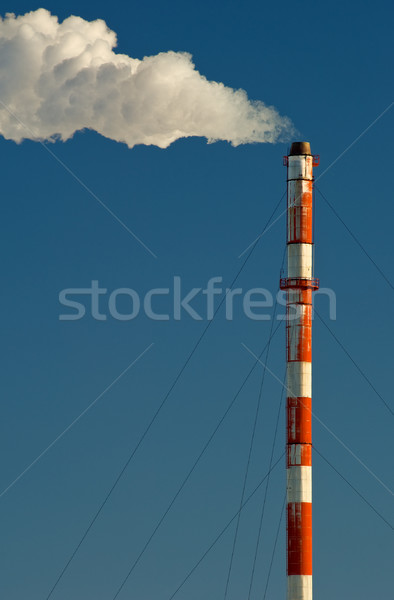 Industrial smokestack with smoke and steam blowing Stock photo © Habman_18