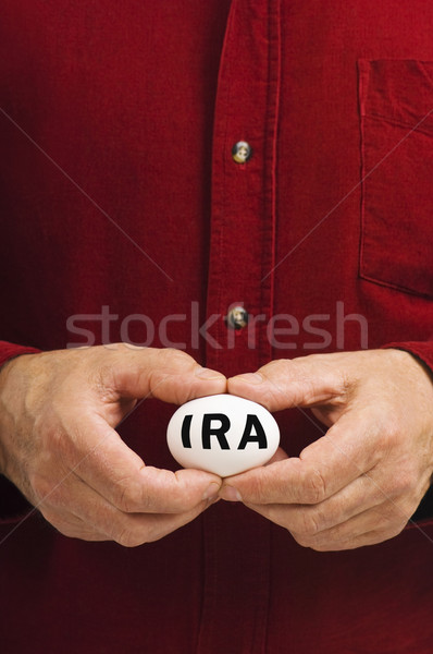 IRA on egg held by man Stock photo © Habman_18
