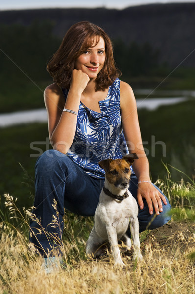 Young girl sits with her pet dog Stock photo © Habman_18