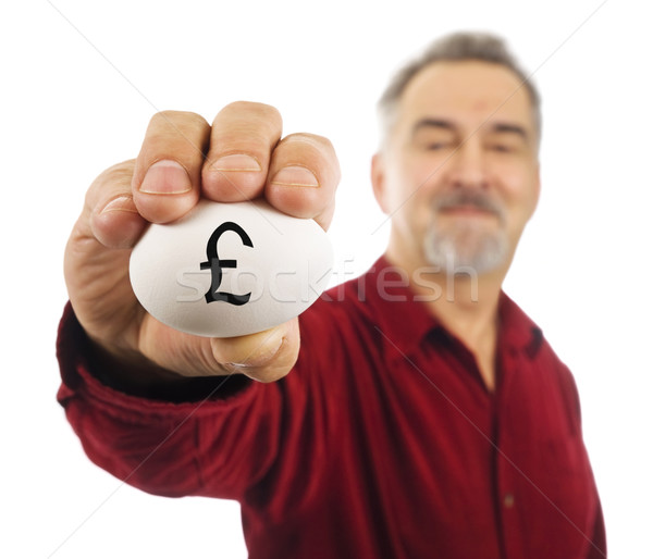 Mature man holds an egg with pound currency symbol Stock photo © Habman_18