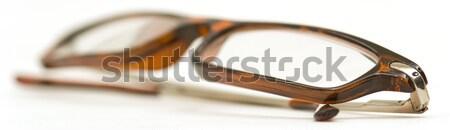 Katlanmış okuma gözlükleri çift silah beyaz Stok fotoğraf © Habman_18