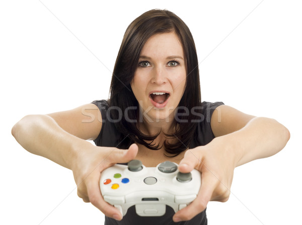 Excited girl holding video game controller Stock photo © Habman_18