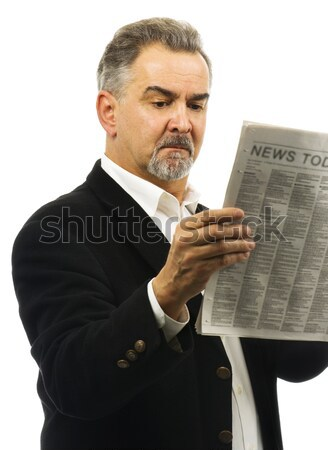 Mature man reads newspaper with serious look on face Stock photo © Habman_18
