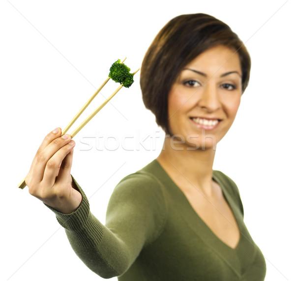 Mosolyog fiatal nő darab zöld brokkoli evőpálcikák Stock fotó © Habman_18