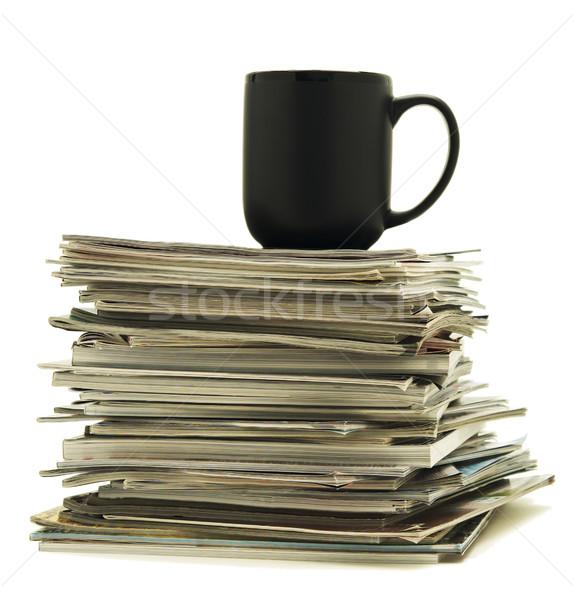 Coffee mug sits on stack of magazines Stock photo © Habman_18