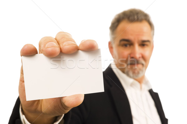 Mature businessman holds a blank business card in his hand Stock photo © Habman_18