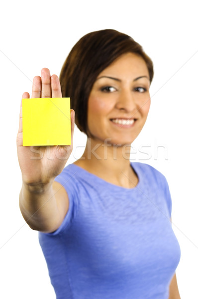 Young woman has a post-it note stuck on her hand. Stock photo © Habman_18