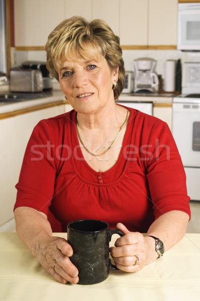 Kıdemli kadın kahve molası mutfak oturma Stok fotoğraf © Habman_18