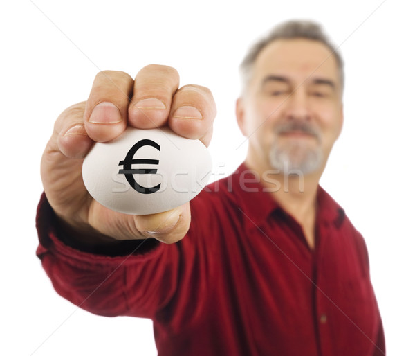 Mature man holds an egg with Euro currency symbol Stock photo © Habman_18