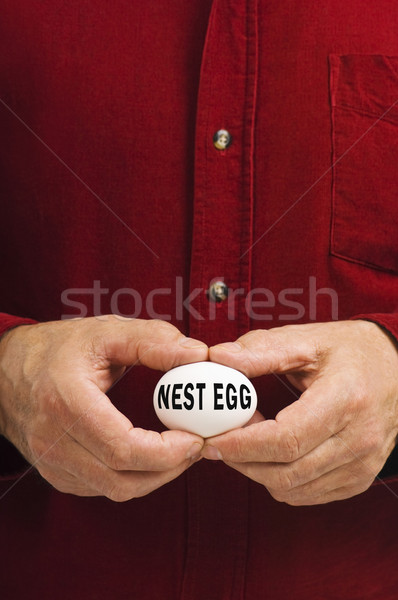 NEST EGG written on egg held by man Stock photo © Habman_18