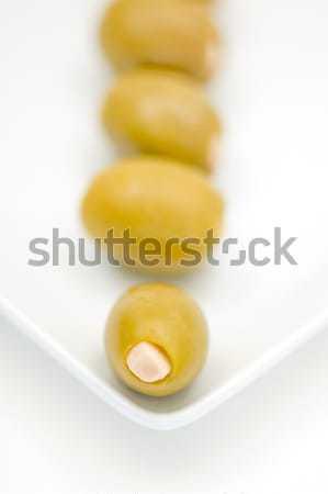 Czosnku nadziewany oliwek biały tablicy shot Zdjęcia stock © Habman_18