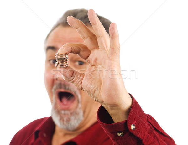 Man holds coins with hand, mouth open. Stock photo © Habman_18