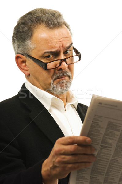 Businessman wearing glasses holds a newspaper. Stock photo © Habman_18