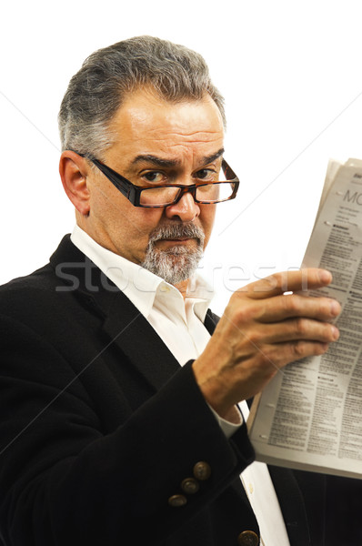 Older businessman reads his newspaper. Stock photo © Habman_18
