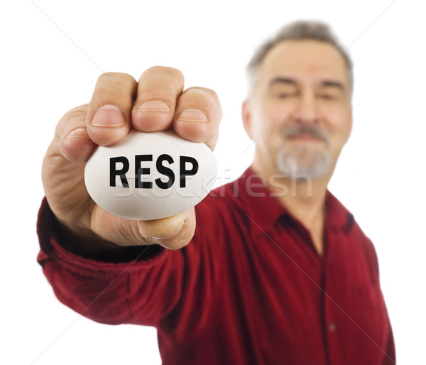 Mature man holds an egg with RESP on it. Stock photo © Habman_18