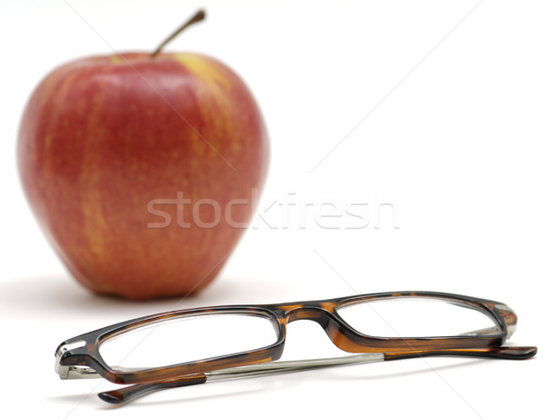 Okuma gözlükleri elma çift silah katlanmış Stok fotoğraf © Habman_18