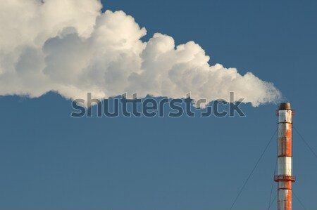Industrial smokestack with smoke and steam billowing Stock photo © Habman_18