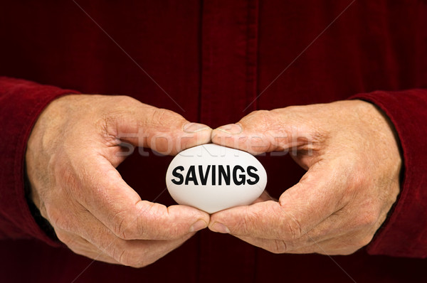 Man holds white egg with SAVINGS written on it Stock photo © Habman_18