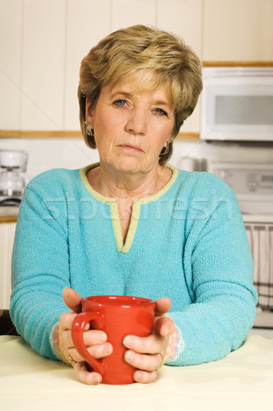 Unhappy senior woman holds a coffee mug Stock photo © Habman_18
