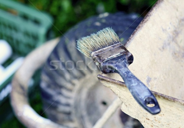 Velho paint brush usado topo carrinho de mão pintura Foto stock © hamik