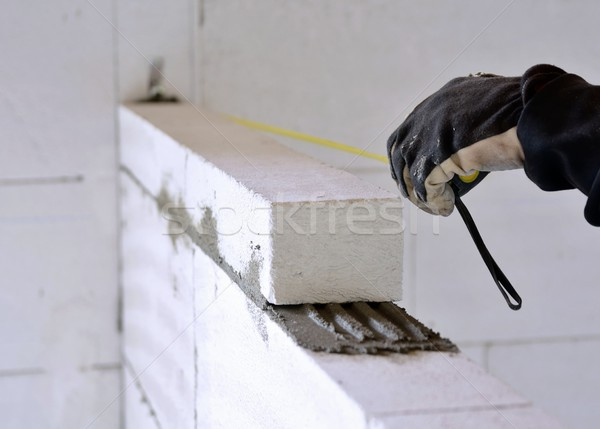 Bricklayer using a tape measure Stock photo © hamik
