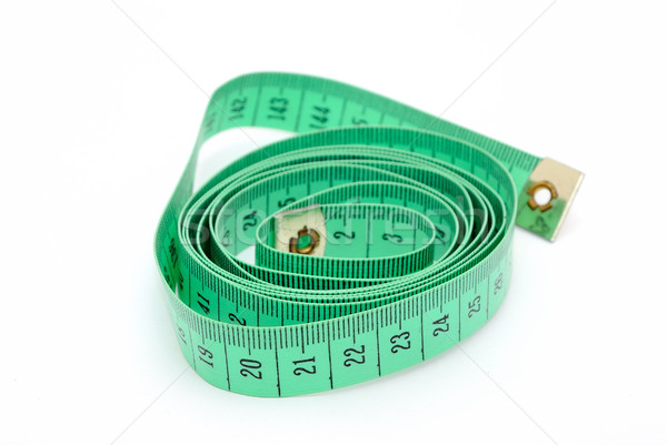 Detail image of twisted green inch tape.  Stock photo © hamik