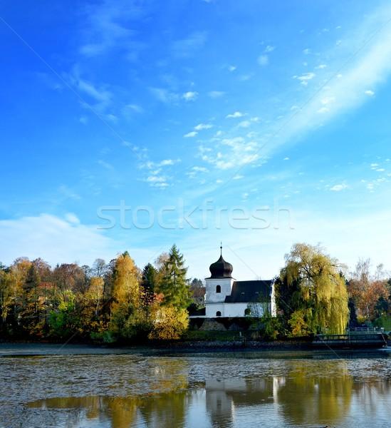 Igreja lagoa reflexão água blue sky árvore Foto stock © hamik