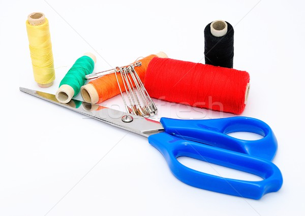 Blue scissors and various colored threads.  Stock photo © hamik