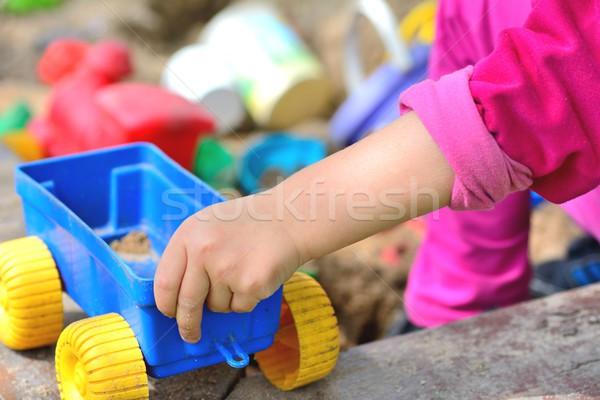 Playing at sandpit Stock photo © hamik