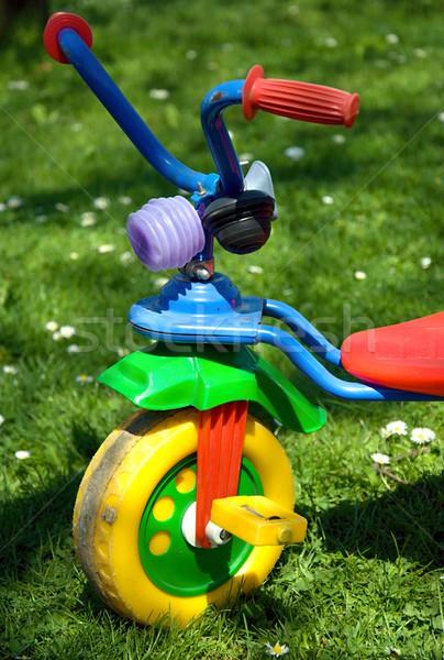üç tekerlekli bisiklet bahçe bahar çim çocuk bar Stok fotoğraf © hamik