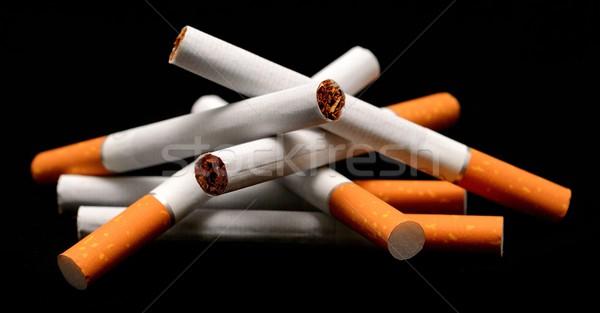 Foto stock: Cigarros · preto · saúde · fundo · charuto