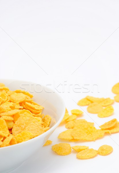 Arany gabonapehely fehér edény asztal egészség Stock fotó © hamik